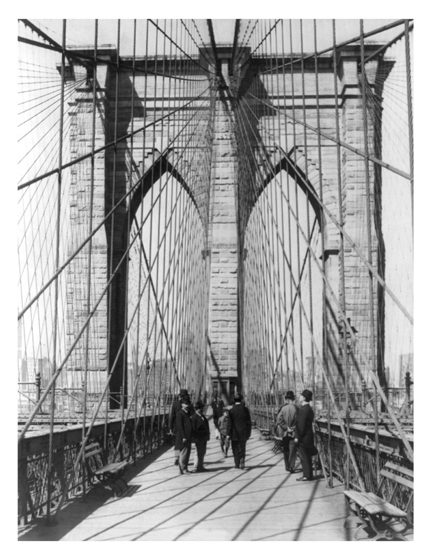 Vintage photo from 1898 of the Brooklyn Bridge with men standing on the roadway.